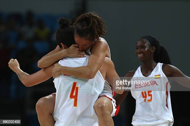 Laia Palau of Spain jumps onto Laura Nicholls against Spain they celebrate following the Women's Quarterfinal match between Spain and Turkey at...