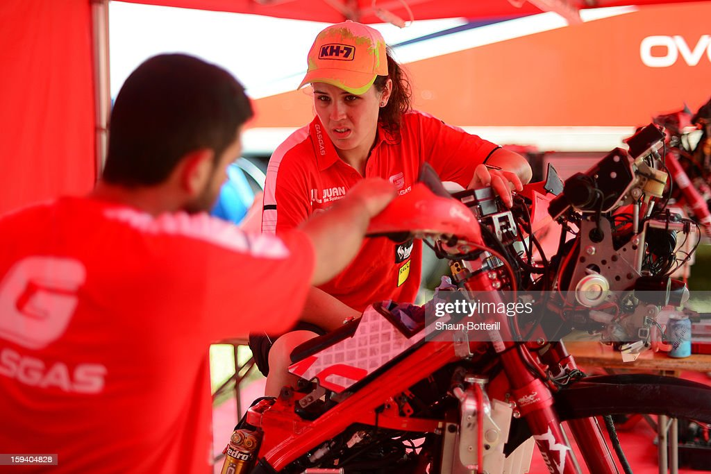 Laia Sanz of team Gas-Gas talks with her mechanic on the rest day of the 2013 Dakar Rally on January 13, 2012 in Tucuman, Argentina.