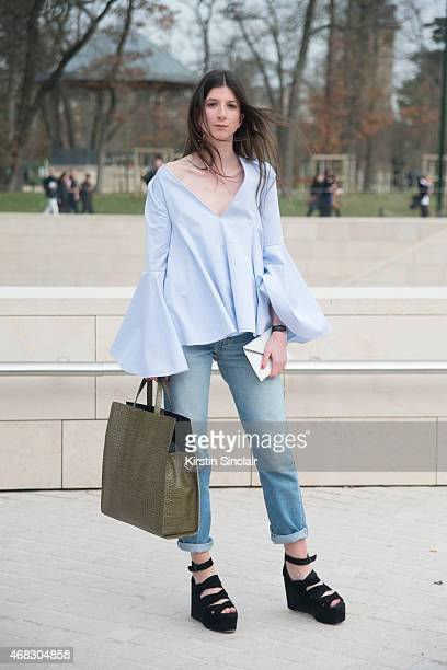 Laiaeni Popton wears an Ellery top and shoes Leviâs jeans Lithe Efina bag and Zara earring on day 9 of Paris Collections Women on March 11 2015 in...