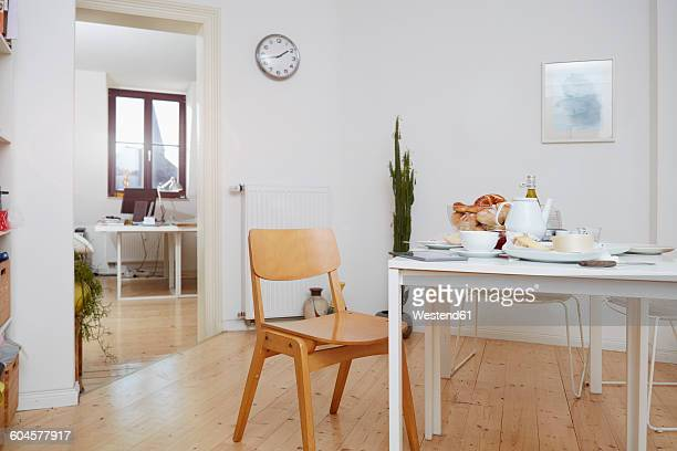 Laid breakfast table in a flat