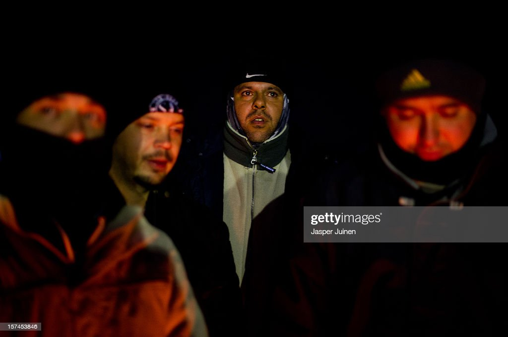 Laid off workers of the Artevi door factory stand around a fire to stay warm during a picket in the middle of the night to prevent machinery leaving the factory, to demand salary payment from over six months old and a lay off settlement, for some for over 25 years, on December 01, 2012 in Villacanas, Spain. During the boom years, where in its peak Spain built some 800,000 houses a year accompanied by the manufacturing of millions of wooden doors, the people of Villacanas were part of Spain's middle class enjoying high wages and permanent jobs. During the construction boom years the majority of the doors used within these new developments were made in this small industrial town. Approximately seven million doors a year were once assembled here and the factories employed a workforce of almost 5700 people, but the town is now left almost desolate with the Villacanas industrial park now empty and redundant. With Spain in the grip of recession and the housing bubble burst, Villacanas is typical of many former buoyant industrial Spanish towns now struggling with huge unemployment problems.
