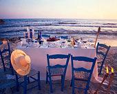 Laid table on beach at twilight