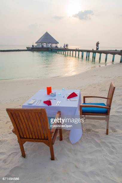 Laid Tables for a Romantic Dinner at the White Sandy Beach of Coco Bodu Hiti NorthMaleAtoll on February 24 2017 in Male Maldives