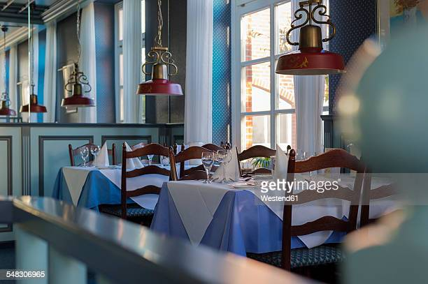 Laid tables in restaurant