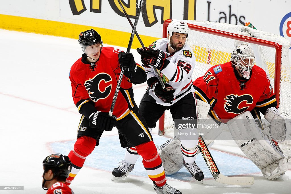 Laidslav Smid #3 and goalie Karri Ramo #31 of the Calgary Flames defend against <a gi-track='captionPersonalityLinkClicked' href=/galleries/search?phrase=Brandon+Bollig&family=editorial&specificpeople=7186858 ng-click='$event.stopPropagation()'>Brandon Bollig</a> #52 of the Chicago Blackhawks at Scotiabank Saddledome on January 28, 2014 in Calgary, Alberta, Canada.