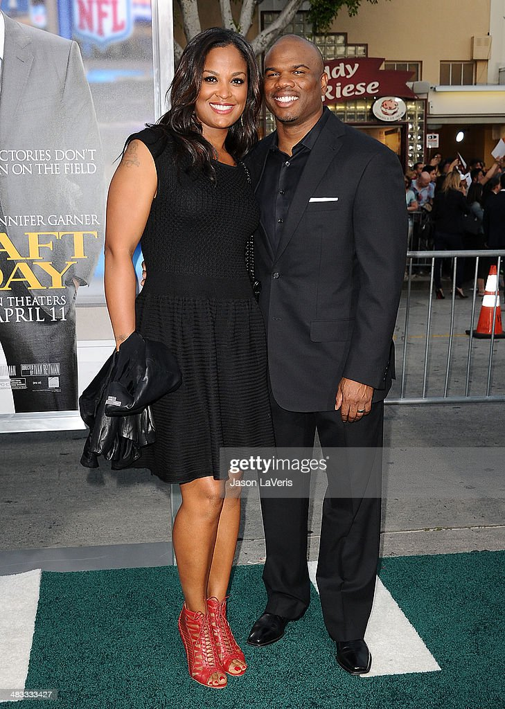 Laila Ali and Curtis Conway attend the premiere of 'Draft Day' at Regency Bruin Theatre on April 7 2014 in Los Angeles California
