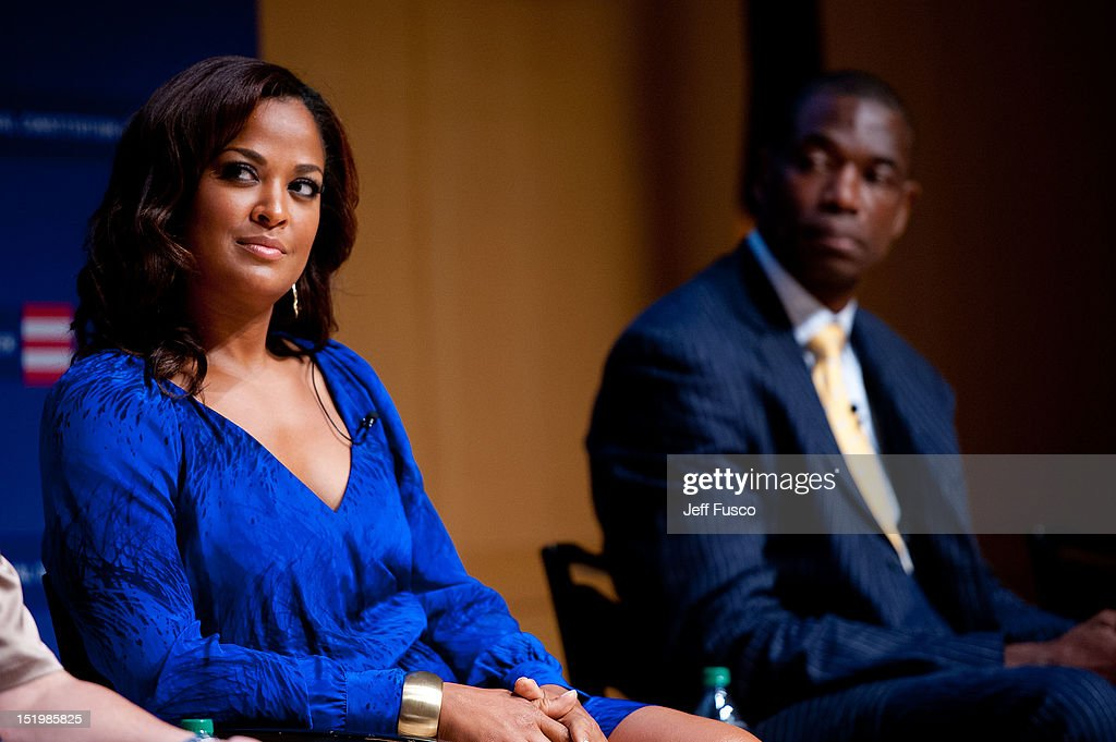 Laila Ali (L) and Dikembe Mutombo take part in a panel discussion prior to the 2012 Liberty Medal Ceremony at the National Constitution Center on September 13, 2012 in Philadelphia, Pennsylvania.