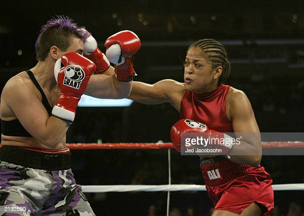 Laila Ali hits Valerie Mahfood during their women's super middleweight bout at the Staples Center on June 21 2003 in Los Angeles California Laila Ali...
