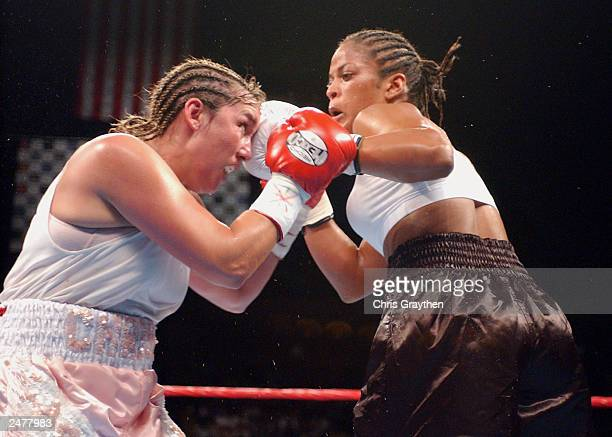 Laila Ali lands a lefthand punch to the face of Christy Martin on August 23 2003 at the Mississippi Coast Coliseum in Biloxi Mississippi Ali knocked...
