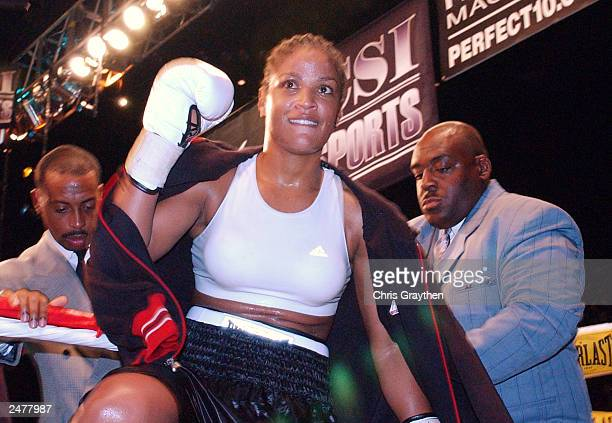 Laila Ali looks on as she enters the ring before her fight against Christy Martin on August 23 2003 at the Mississippi Coast Coliseum in Biloxi...
