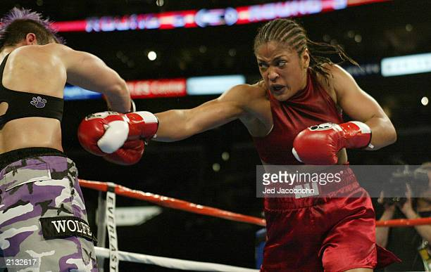 Laila Ali throws a punch at Valerie Mahfood during their women's super middleweight bout at the Staples Center on June 21 2003 in Los Angeles...