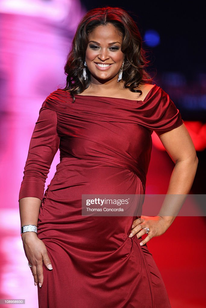 Laila Ali wearing 'a pea in the pod' at the The Heart Truth's Red Dress Collection fashion show during Mercedes-Benz Fashion Week Fall 2011 at Lincoln Center on February 9, 2011 in New York City.