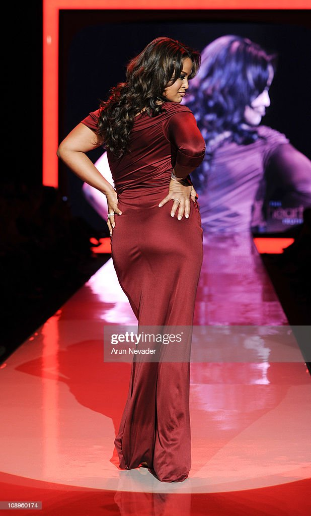 Laila Ali wearing 'a pea in the pod' walks the runway at the Heart Truth Fall 2011 fashion show during Mercedes-Benz Fashion Week at The Theatre at Lincoln Center on February 9, 2011 in New York City.