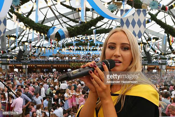 Laila Noeth the Muenchner Kindl Oktoberfest female patron sings on stage during the opening day of the 2015 Oktoberfest on September 19 2015 in...