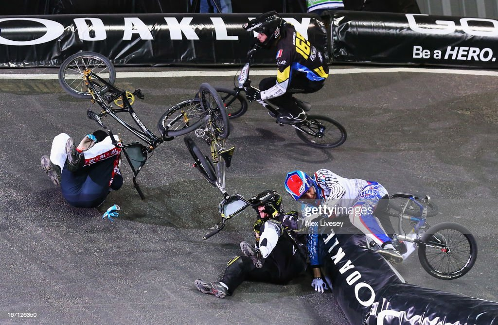 Lain van Ogle of USA crashes with Rihards Veide of Latvia during the Men's Elite 1/8 Finals 2nd round race in the UCI BMX Supercross World Cup at the National Cycling Centre on April 20, 2013 in Manchester, England.