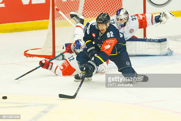 Laine Teemu of HV71 focused on the puck with Alexander Cijan of Red Bull Salzburg and Luka Gracnar Goaltender of Red Bull Salzburg behind him during...