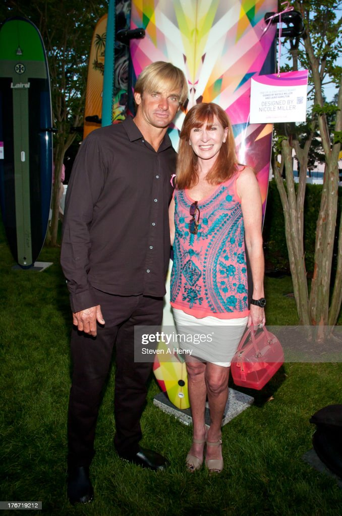 Laird Hamilton and Nicole Miller attend the 2nd annual Paddle & Party for Pink on August 17, 2013 in Sag Harbor, New York.