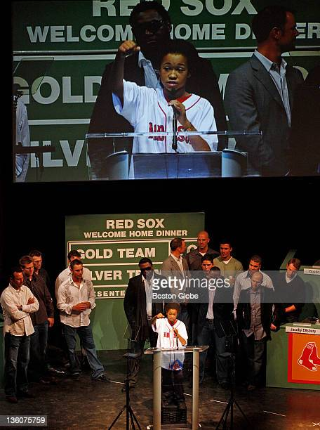 LaJuan Allen the Red Sox scholar class of 2007 stands on a milk crate in front of Boston Red Sox players during the Red Sox Foundation Welcome Home...