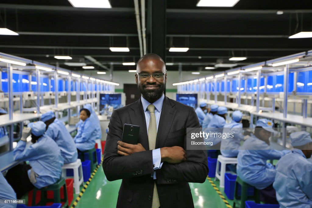 Lakan Akinjide, managing director of AfriOne Ltd., poses for a photograph on the production floor during a launch event for the AfriOne Gravity Z1 smartphone at the new AfriOne Ltd. manufacturing plant in Lagos, Nigeria, on Friday, April 21, 2017. The plant has the capacity to produce some 120,000 units per month. Photographer: George Osodi/Bloomberg via Getty Images