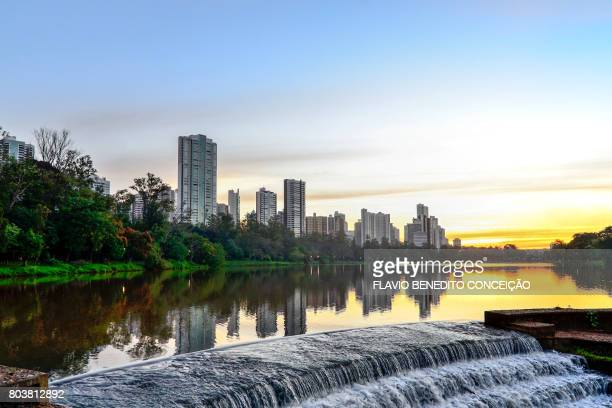 Lake and buildings with the sunset in the city of Londrina in Brazil