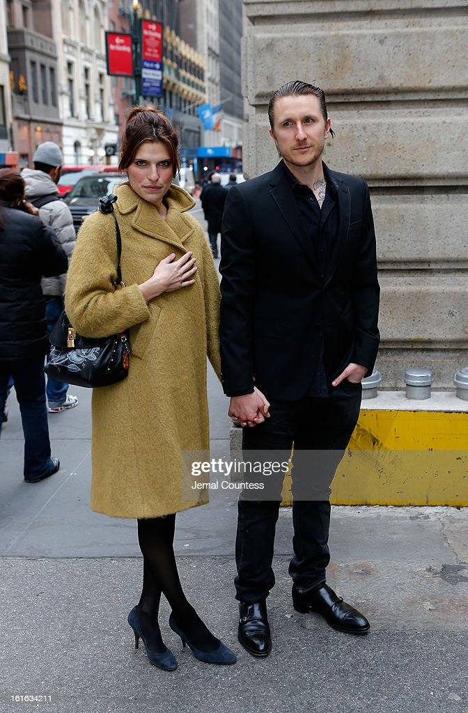 Lake Bell (L) and Scott Campbell arrive backstage at the Marchesa Fall 2013 fashion show during Mercedes-Benz Fashion Week at The New York Public Library on February 13, 2013 in New York City.