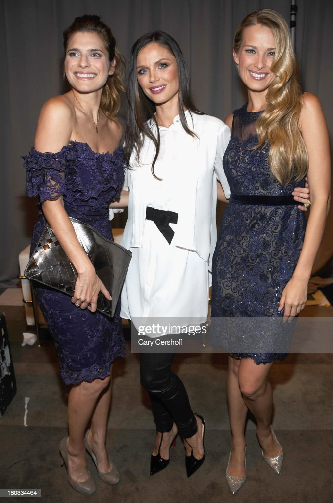 <a gi-track='captionPersonalityLinkClicked' href=/galleries/search?phrase=Lake+Bell&family=editorial&specificpeople=209336 ng-click='$event.stopPropagation()'>Lake Bell</a>, Georgina Chapman and <a gi-track='captionPersonalityLinkClicked' href=/galleries/search?phrase=Petra+Nemcova&family=editorial&specificpeople=201716 ng-click='$event.stopPropagation()'>Petra Nemcova</a> attend the Marchesa show during Spring 2014 Mercedes-Benz Fashion Week at New York Public Library on September 11, 2013 in New York City.