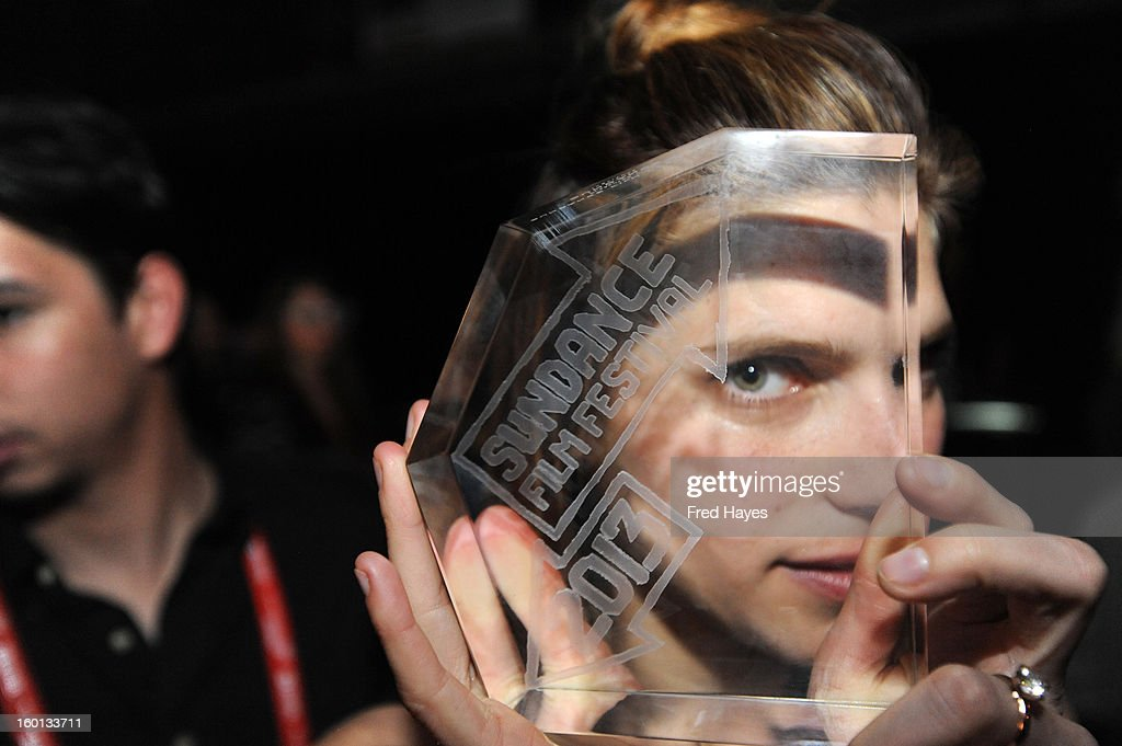 <a gi-track='captionPersonalityLinkClicked' href=/galleries/search?phrase=Lake+Bell&family=editorial&specificpeople=209336 ng-click='$event.stopPropagation()'>Lake Bell</a> winner of the Waldo Salt Screenwriting Award: U.S. Dramatic for In A World poses with award at the Awards Night Ceremony during the 2013 Sundance Film Festival at Basin Recreation Field House on January 26, 2013 in Park City, Utah.