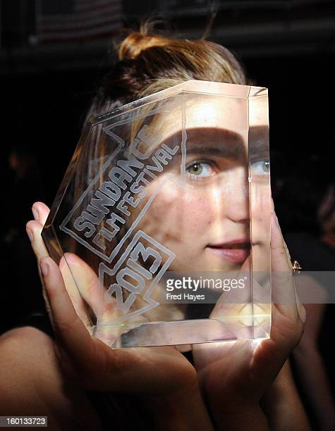 Lake Bell winner of the Waldo Salt Screenwriting Award US Dramatic for In A World poses with award at the Awards Night Ceremony during the 2013...
