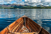 A wooden rowing boat on Lake Derwentwater in the English Lake District.