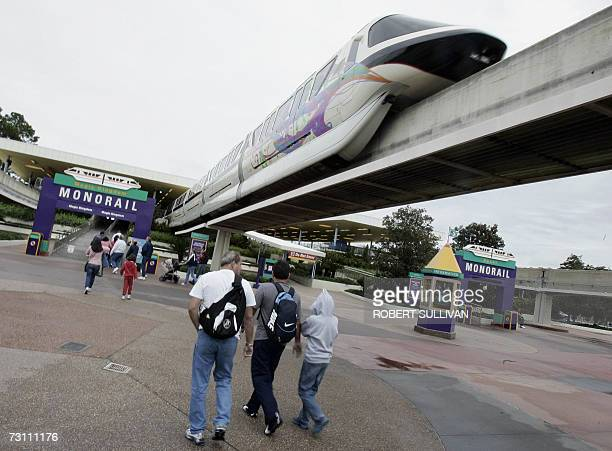 Visitors to Walt Disney World walk toward the Mono Rail train station 25 January 2007 in Lake Buena Vista Florida Disney is celebrating a Year of a...