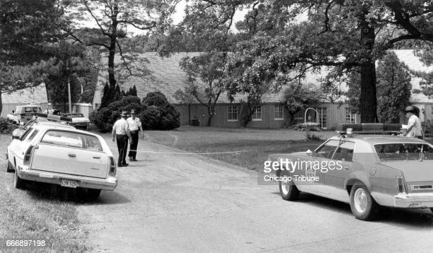 Lake County Sheriff's Deputies stand outside the property of Bruce and Darlene Rouse at 2057 N Milwaukee Ave north of Libertyville Ill on June 6 1980...