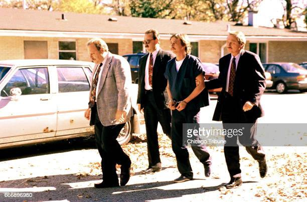 Lake County Sheriff's Police lead William Rouse to juvenile court in Waukegan Ill on Oct 16 1995 Rouse confessed to killing his parents Bruce and...