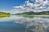 Lake Fuschl (Fuschlsee) near Fuschl am See under blue sky with white clouds in summer, Salzburg state, Salzkammergut, Austria, Europe