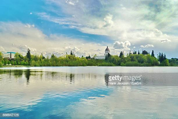 Lake In Front Of Washington State Capitol Against Cloudy Sky