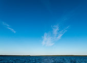 Lake Manitou Cirrus Clouds landscape on sunny day with cirrus cloud on Manitoulin Island