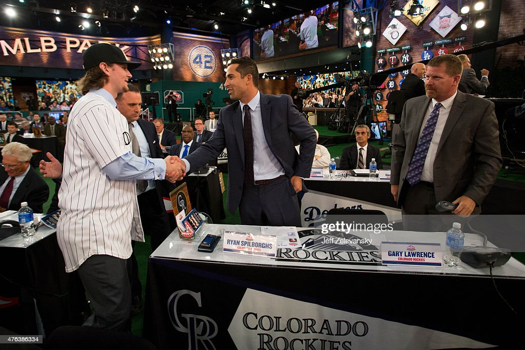 Lake Mary High School shortstop Brendan Rodgers meets with Colorado Rockies Club representatives Ryan Spilborghs and Gary Lawrence after being...