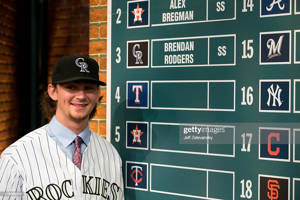 Lake Mary High School shortstop Brendan Rodgers places his name on the draft board after being selected third overall by the Colorado Rockies during...