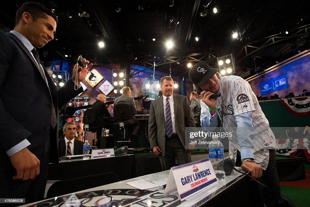 Lake Mary High School shortstop Brendan Rodgers talks with the Colorado Rockies front office after being selected third overall during the 2015 Major...