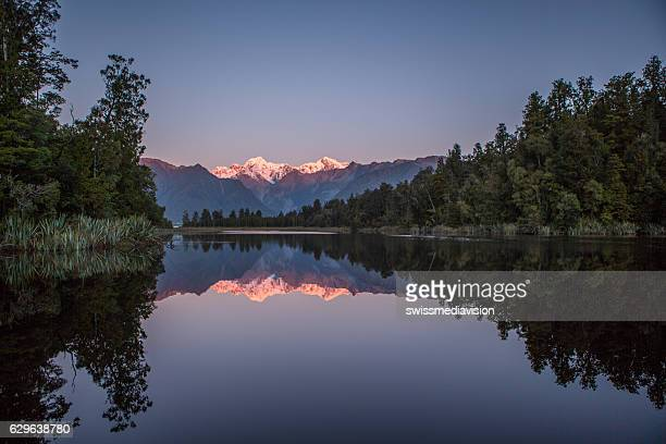 Lake Matheson And The Southern Alps At Dusk
