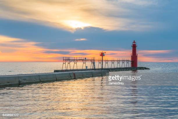 Lake Michigan Sunrise with iconic pier and Lighthouse.