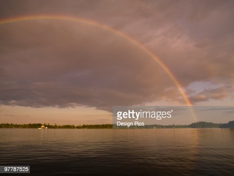 Lake of the woods, Ontario, Canada, Rainbow over the lake : Stock Photo