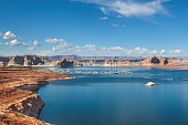 Summer photo of Lake Powell, a large reservoir on the border of Utah and Arizona.