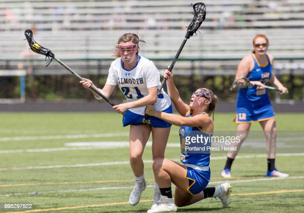 Lake Region junior Olivia Deschenes falls down as she tries to block Falmouth senior Sydney Bell during their semifinal game at Falmouth High School...