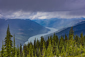 An elevated view of Lake Revelstoke from Mount Revelstoke British Columbia Canada on a stormy day