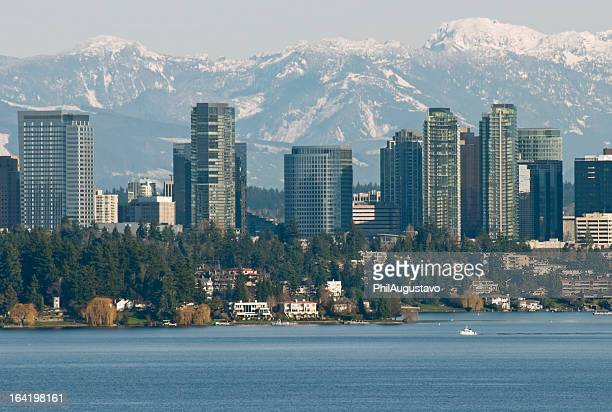 Lake Washington and city of Bellevue with mountain range behind