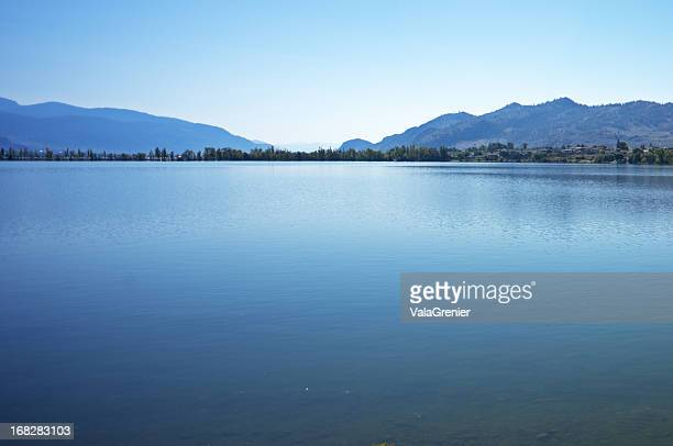 Lake with blue mountains and sky.