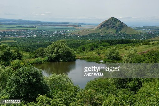 Lake with water lilies among the mountains : Stock Photo