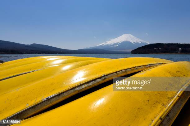 Lake Yamanaka with Mt. Fuji background at Yamanashi, Japan. Lake Yamanaka is a point of view Mount Fuji is very popular for photographers and tourists.