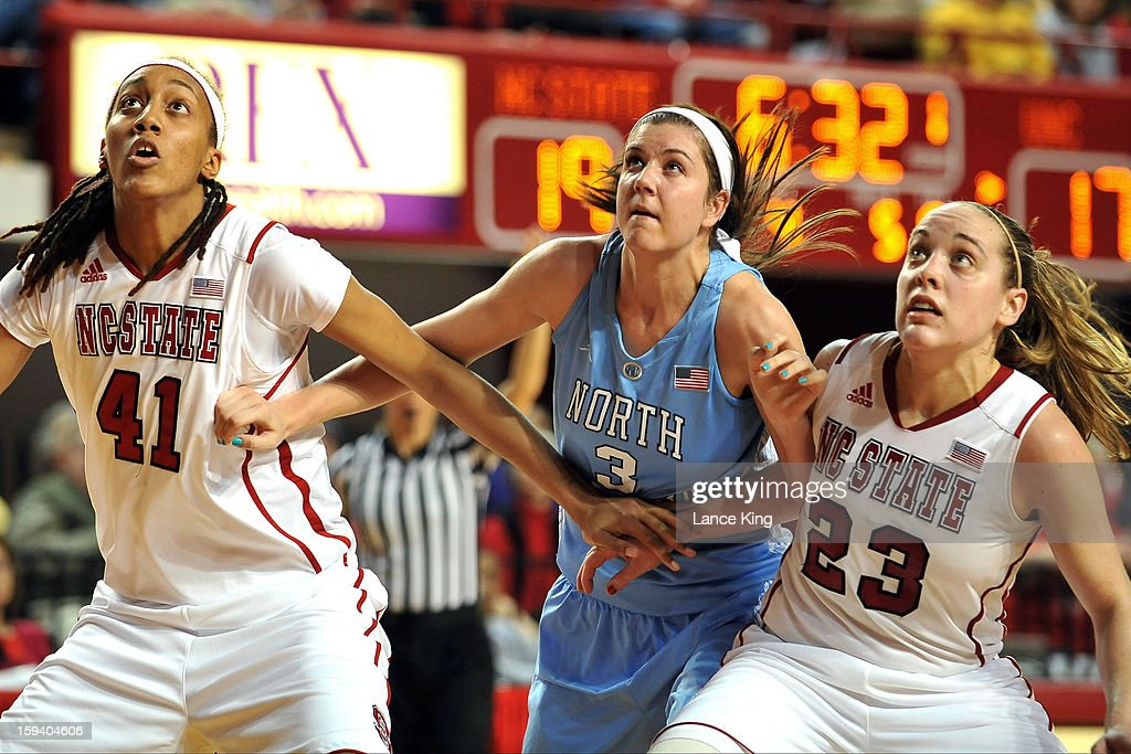 Lakeesa Daniel #41 and Marissa Kastanek #23 of the North Carolina State Wolfpack fight for position against Megan Buckland #3 of the North Carolina Tar Heels at Reynolds Coliseum on January 10, 2013 in Raleigh, North Carolina.