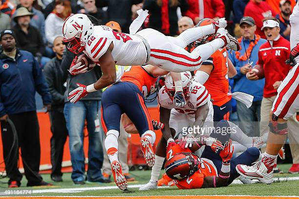 LaKeith Walls of the Illinois Fighting Illini dives into the end zone for a touchdown against the Illinois Fighting Illini at Memorial Stadium on...